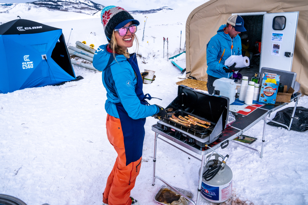 A volunteer cooks bacon at the Bluebird Backcountry ski area.
