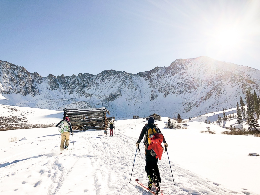 Backcountry skiers follow a popular skin track in Colorado's Rocky Mountains.