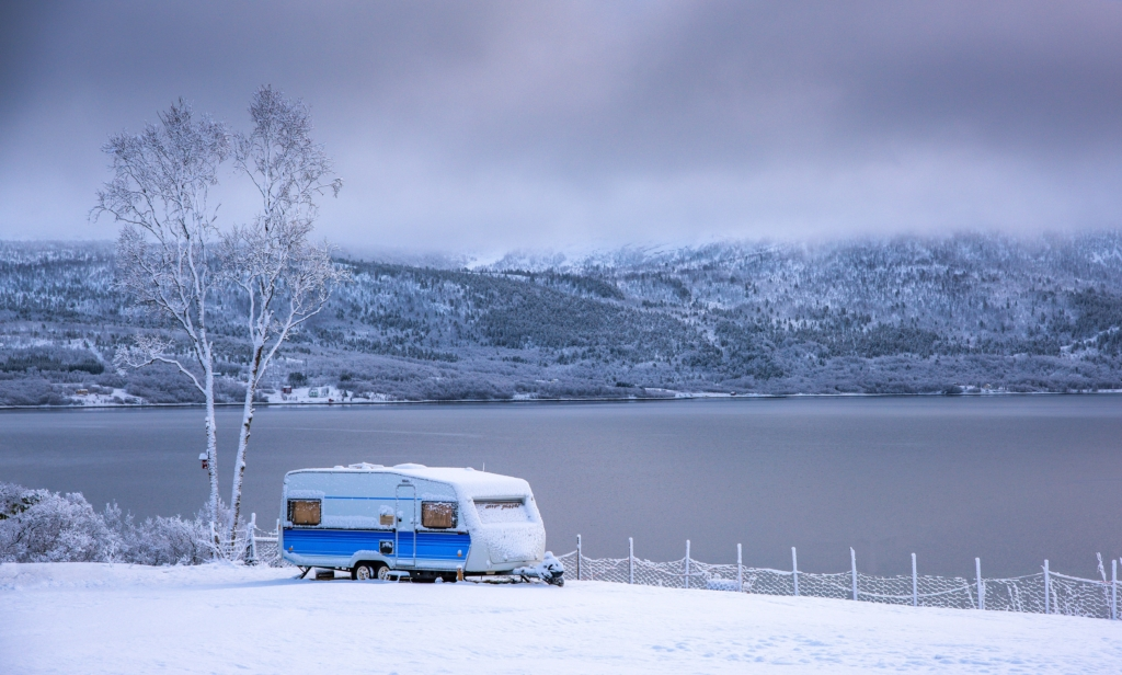 A camper trailer parked in the snow demonstrates how effective a propane heating system can be.