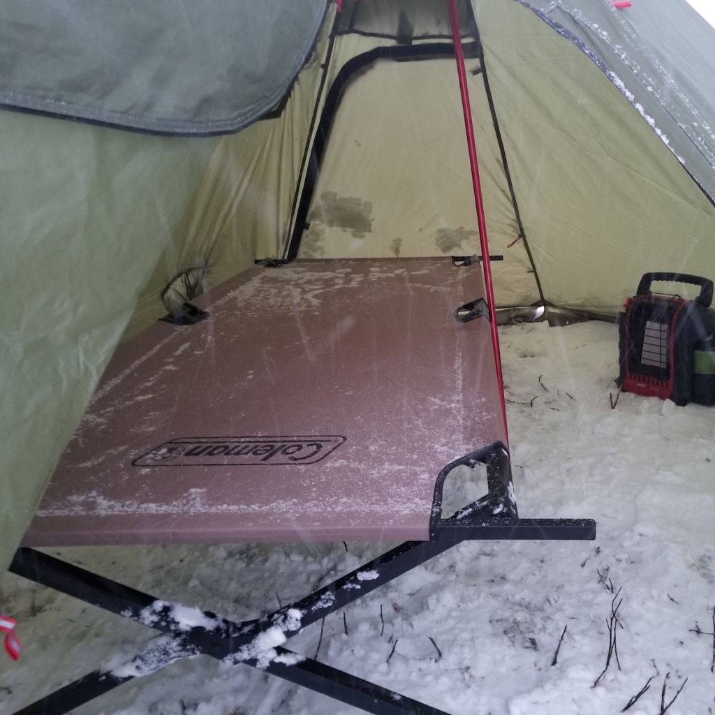 A pyramid tent with a propane heater