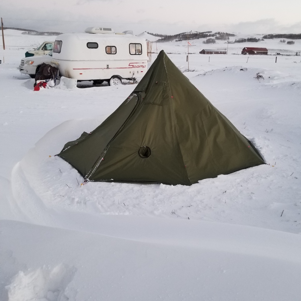 A pyramid tent setup for winter camping