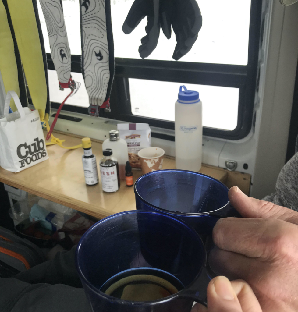 Skiing skins dry in a warm winter van setup